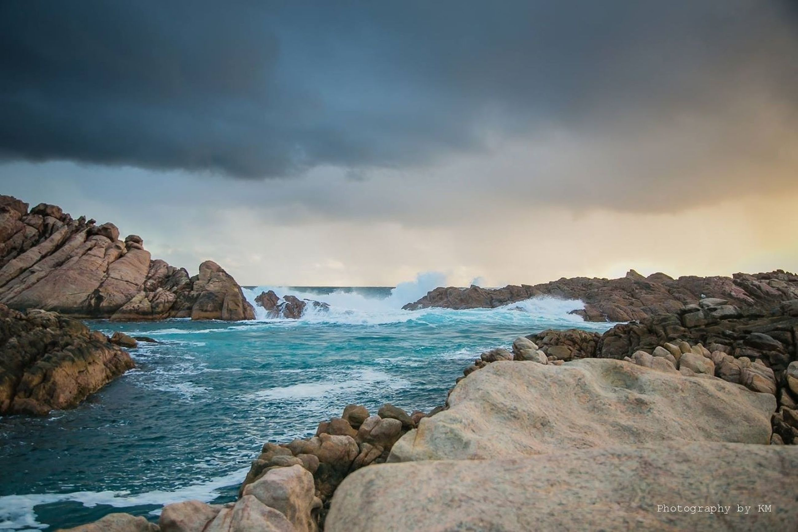 sea, water, scenics, sky, rock - object, beauty in nature, tranquil scene, tranquility, rock formation, nature, cloud - sky, horizon over water, rock, idyllic, cloudy, shore, beach, cloud, outdoors, cliff