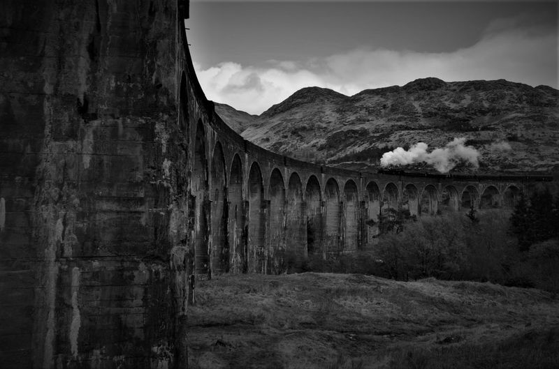 Architecture Beautiful Beauty In Nature Black And White Bridge Glenfinnan Glenfinnan Viaduct Jacobite Mountain Scotland Smoke Steam Steam Train Train Long Goodbye EyeEmNewHere Farewell The Great Outdoors - 2017 EyeEm Awards Live For The Story The Week On EyeEm Lost In The Landscape Been There. It's About The Journey