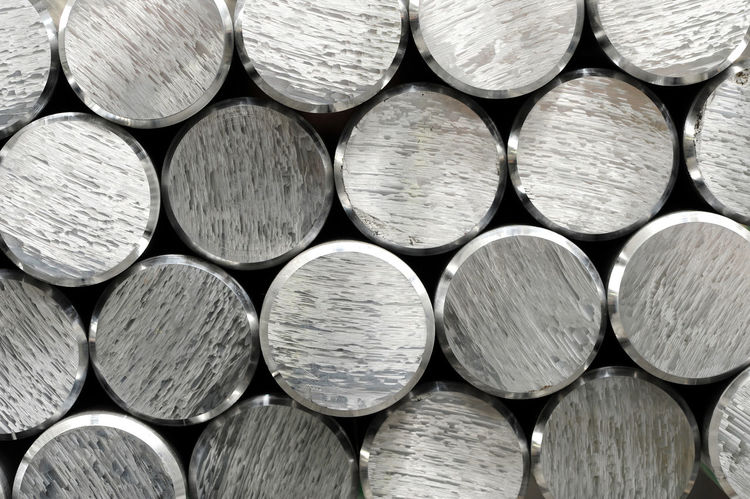 Background texture and pattern of aluminium bars with focus to the cut and bevelled ends of the round metallic silver rods in a full frame view Industry Production Aluminium Backgrounds Bars Bevelled Circular Cute Ends Engineering Factory Full Frame Metal Rods Silver  Stack