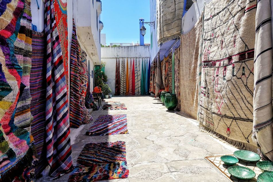 Morocco Photos Alley Town Travel Display Carpet Display Wall Town View Sights & Views  Rural Scene Miro AlleyEnjoying The View Morocco Narrow Path Architecture Shop Building Exterior Built Structure Outdoors Sunlight No People Multi Colored Scenics Streamzoofamily