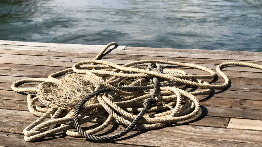 High angle view of rope tied to pier