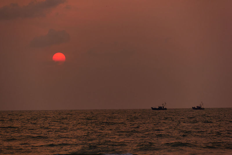 Amazing View Beautiful Sunset Beauty In Nature Boat Boats⛵️ Fishing Boat Horizon Over Water Mode Of Transport Nautical Vessel Rippled Sea Sun Sunset Sunset #sun #clouds #skylovers #sky #nature Beautifulinnature Naturalbeauty Photography Landscape [a:1286387] Sunsetlover Tranquil Scene Transportation Arabian Sea Manipal Let's Go. Together. Sommergefühle EyeEm Selects EyeEm Selects