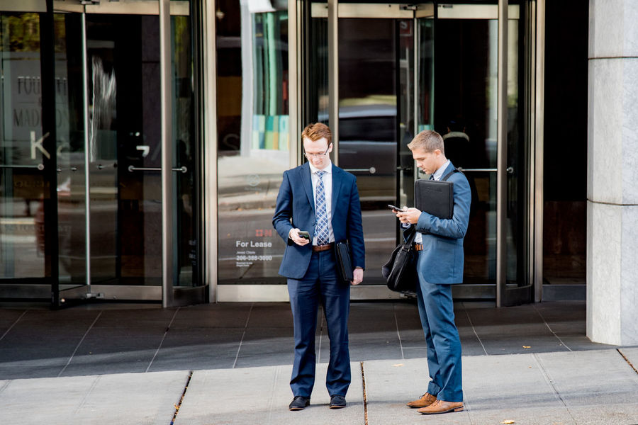Businessmen scheduling a meeting outside Adults Only Business Business Finance And Industry Business Person Businessman Candid Communication Connection Corporate Business Digital Tablet Discussion Men Millennials Only Men People Real People Standing Suits  Teamwork Technology Texting Two People Well-dressed Working Young Adult
