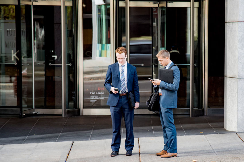 Money Matters Adult Adults Only Business Business Finance And Industry Business Person Businessman Candid Communication Connection Corporate Business Digital Tablet Discussion Full Length Holding Mature Adult Mature Men Men Only Men People Real People Standing Teamwork Togetherness Two People Well-dressed