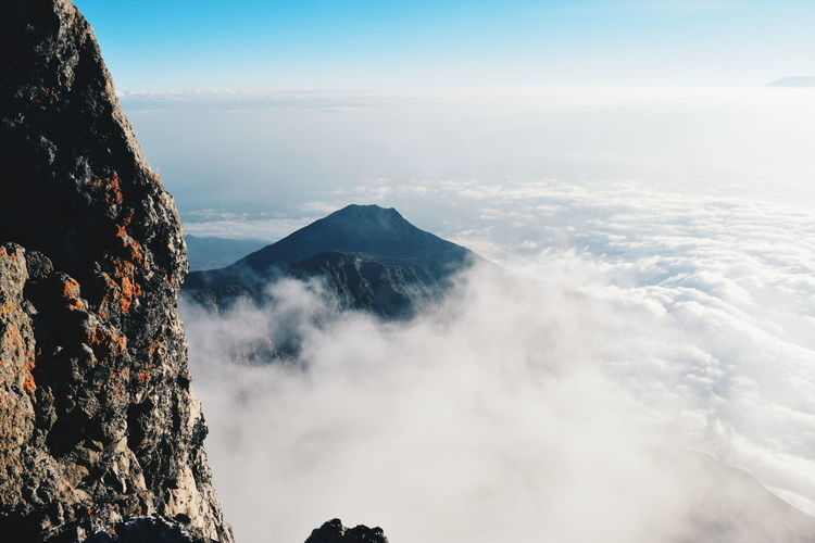 Above the clouds at Mount Meru, Arusha National Park Above The Clouds Mount Meru Arusha National Park Mountaineering Hike Travel Mountain Range Golden Hour Mountaineering Mountains Landscape Mountain Blue Sky