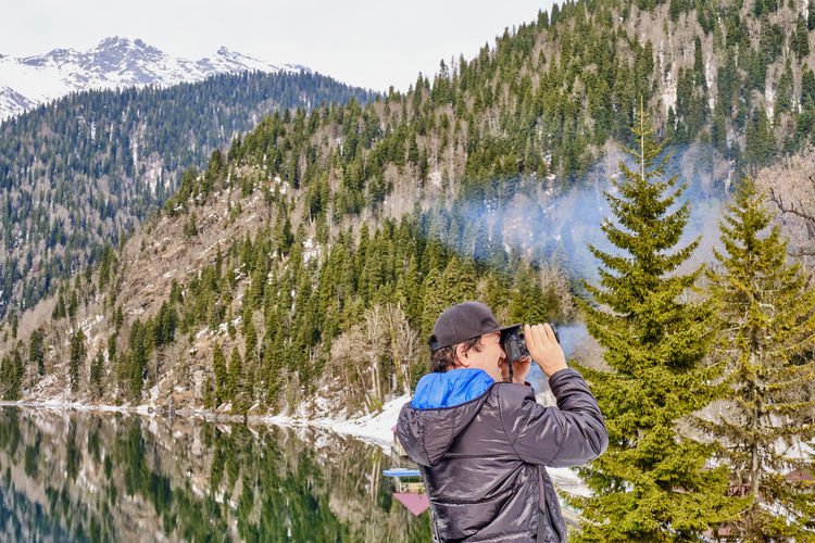 Full length of man photographing on mountain