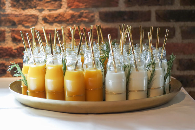 Close-up of straws in jars on table