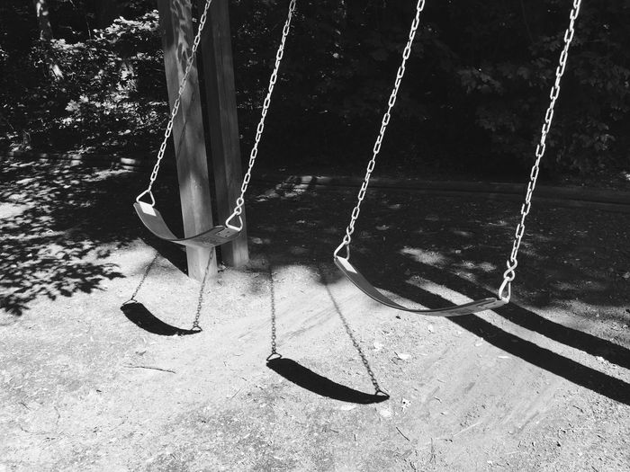 View of empty swings in playground