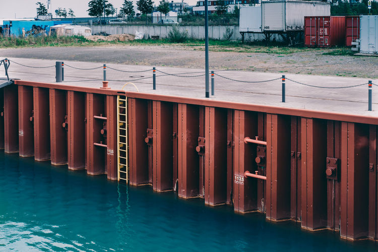 Dive in Diagonal EyeEm Best Shots EyeEmNewHere Harbor Harbour Ladder Lines Orange Red Seashore Architecture Background Building Exterior Built Structure Day Nautical Vessel No People Ocean Outdoors Tree Water Waterfront Yellow