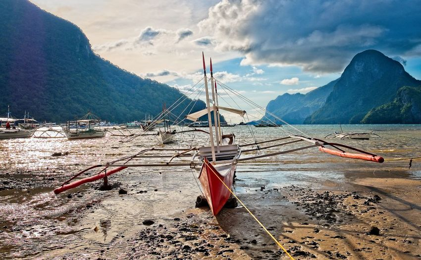 Palawan Philippines Mountain Water Nautical Vessel Nature Transportation Sky Cloud - Sky No People Mountain Range Mode Of Transportation Day Land Beach Beauty In Nature Tranquility Tranquil Scene Scenics - Nature Outdoors Moored Sailboat Palawan Philippines Beached Boat Boat Resort Ocean
