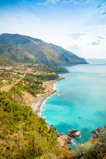 Italy Sicily Scenics - Nature Water Beauty In Nature Mountain Sea Tranquil Scene Land Tranquility Sky Beach High Angle View Nature Day Cloud - Sky Tree Idyllic Plant Non-urban Scene Coastline No People Outdoors Turquoise Colored Bay