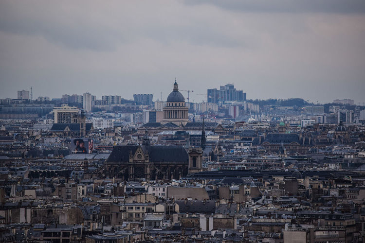 The view on the parisian rooftops from montmartre on a gloomy day, or, the french capital cityscape.