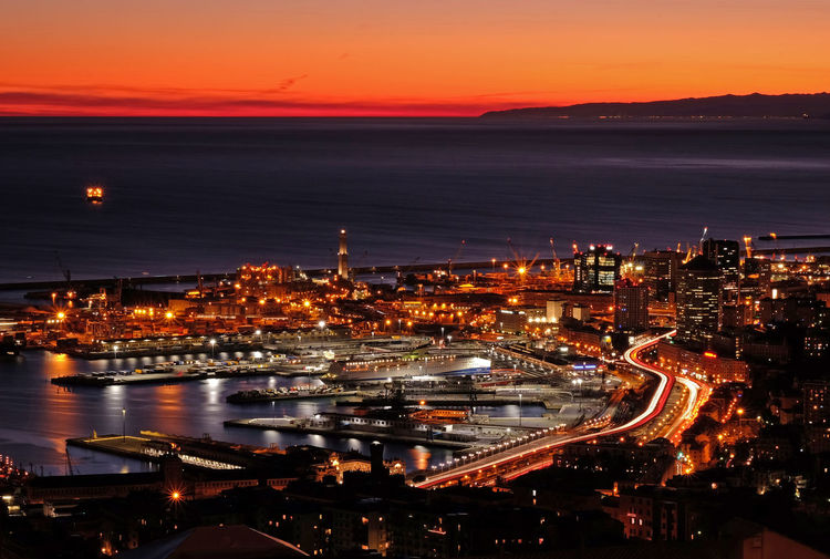 Genova Italia Landscape_Collection Architecture Building Exterior Built Structure City City Life Cityscape High Angle View Horizon Over Water Illuminated Italy Landscape Landscape_photography Long Exposure Night No People Orange Color Outdoors Sea Sky Sunset Urban Skyline Mobility In Mega Cities Colour Your Horizn