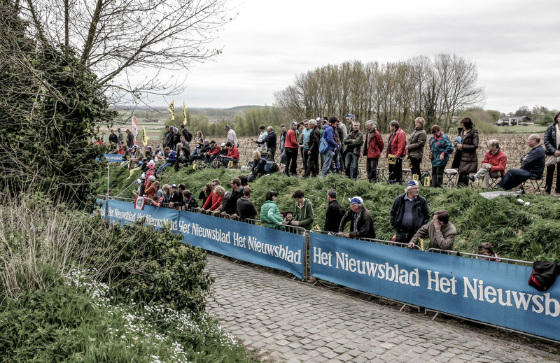CyclingUnites Communication Cycling Day Field Grass Kwarem Large Group Of People Men Nature Oude Kwaremont Outdoors People Real People Sky Text Tree Vlaanderen Women