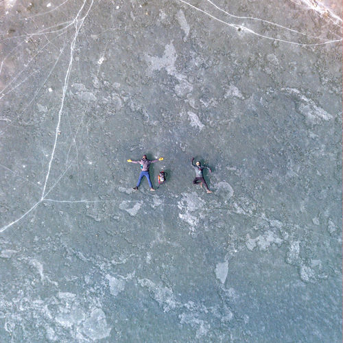 High angle view of men on rock
