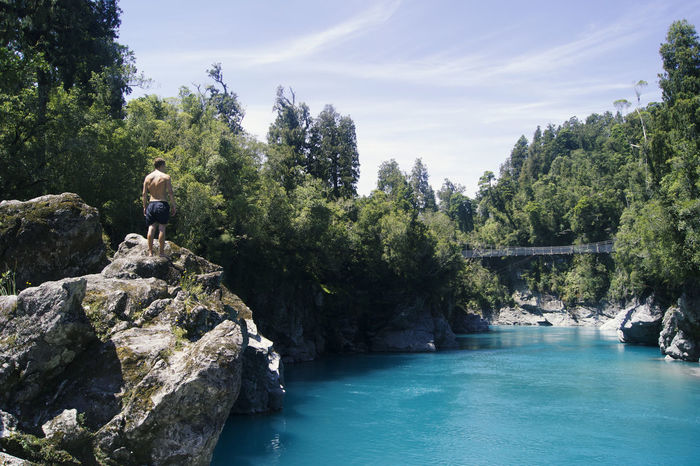 Adults Only Adventure Blue River Cliff Forest Landscape Men Nature One Person Outdoors People Real People River Sky Swingbridge Travel Water Watershots Sommergefühle Connected By Travel