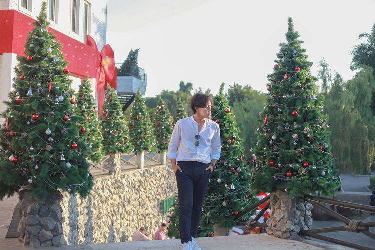 Man standing by christmas tree