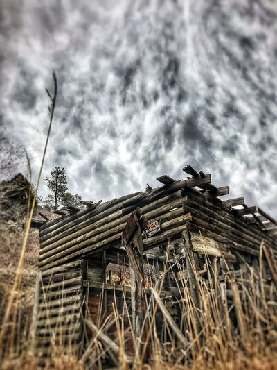 Stack of abandoned roof against sky