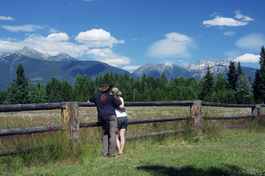 Couple on a farm in the rocky mountains (canada) Couple Farmer Farmland Mountain View Travel Photography Woman Beauty In Nature Boundary British Columbia Canada Farmlife Fence Lifestyles Men Mountain Mountain Range Nature Non-urban Scene Outdoors Real People Rocky Mountains Scenics - Nature Together Togetherness Tranquility