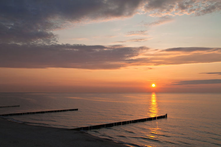Sunset on the Baltic Sea coast. Baltic Sea Beauty In Nature Coast Day Dramatic Sky Groyne Horizon Over Water Nature No People Outdoors Romantic Sky Scenics Sea Shore Sky Sun Sunset Tranquility Vacations Water