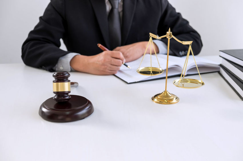Lawyer Balance Barrister Business Business Person Businessman Consultant Fairness Front View Gavel Hand Holding Human Body Part Human Hand Indoors  Judge Judgement Justice Legal Legislation Men Occupation One Person Professional Occupation Verdict