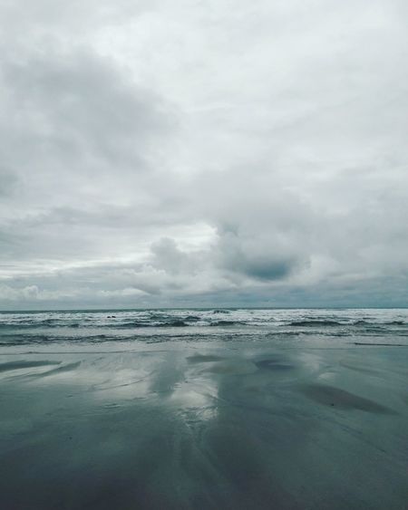 Seaside Reflection Water Tranquility Beauty In Nature Cloud - Sky Scenics Sea No People Outdoors Waterphotography Travel Photography Travel Traveltime Beauty In Nature Wild Ocean View Tides Wave After Wave Rough Sea Grey Sky Stormy Weather