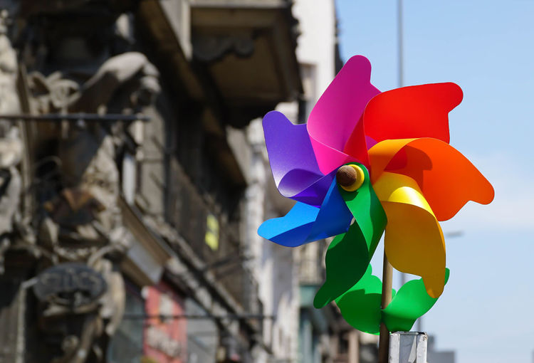 Close-up of multi colored pinwheel against old building