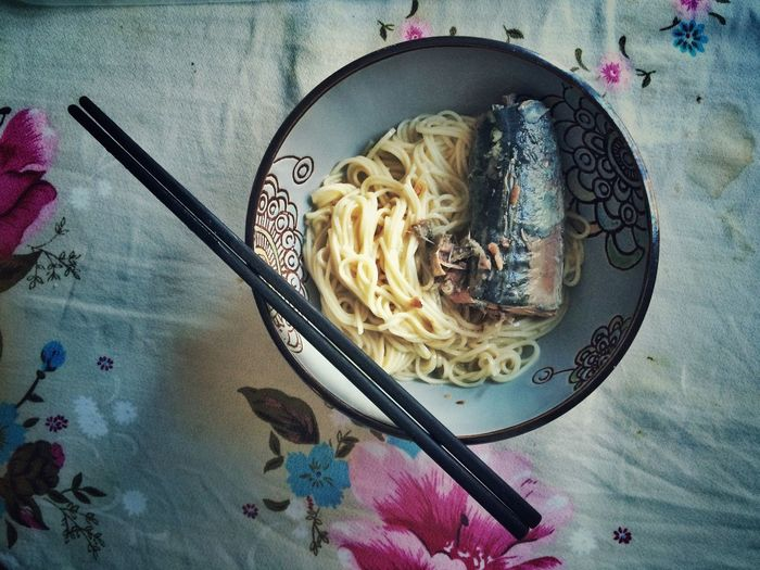 Close-up high angle view of noodles with fish in bowl