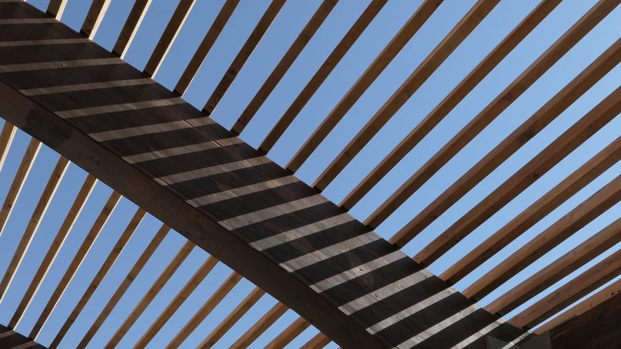 Wood - Material Pattern No People Day High Angle View Architecture Striped Built Structure Outdoors Repetition Full Frame Shadow Backgrounds Sunlight Railing Close-up