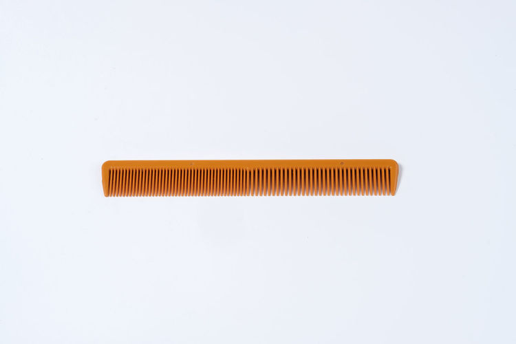 Comb Comb Hair Fur Hair Neat Presentable Tidy White White Background Single Object Still Life Studio Shot Indoors  Close-up Copy Space No People Cut Out Metal Orange Color Hygiene Simplicity High Angle View Pattern White Color Wood - Material Directly Above Equipment Spaghetti Power Supply