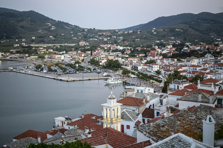 Top view at the skopelos port chora and hills of the skopelos island, greece in summer time.
