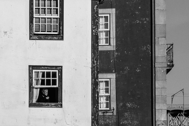 Man at his window, watching down the Porto Ribeira. Architecture Bestoftheday Black And White Blackandwhite Blackandwhite Photography Bridge Building Exterior Built Structure Day Europe Man Melancholy Observing Old Buildings One Person Open Outdoors Porto Portugal Ribeira Slices Watching Watching People Window