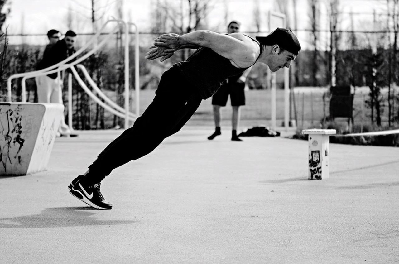 real people, skill, balance, lifestyles, one person, full length, leisure activity, outdoors, focus on foreground, men, motion, day, flexibility, stunt, handstand, performance, breakdancing, skateboard park, adult, people