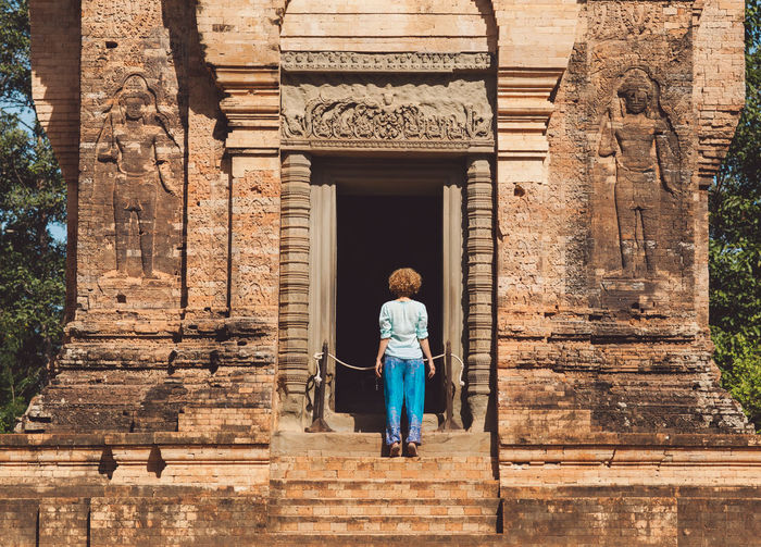 Woman Standing At Entrance Of Temple