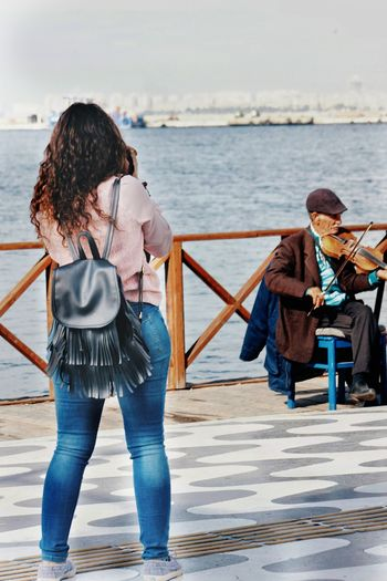 Sea Beach Water Rear View Two People People Happiness Outdoors Young Adult Adult Playing Adults Only Wave Day Violin Violinist
