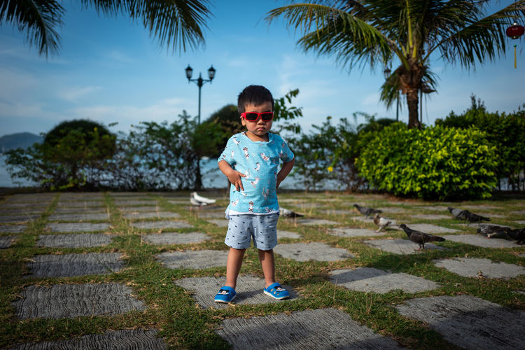 Langkawi Childhood Child Full Length Tree Plant Real People One Person Casual Clothing Boys Standing Males  Sky Innocence Nature Leisure Activity Men Front View Day Outdoors