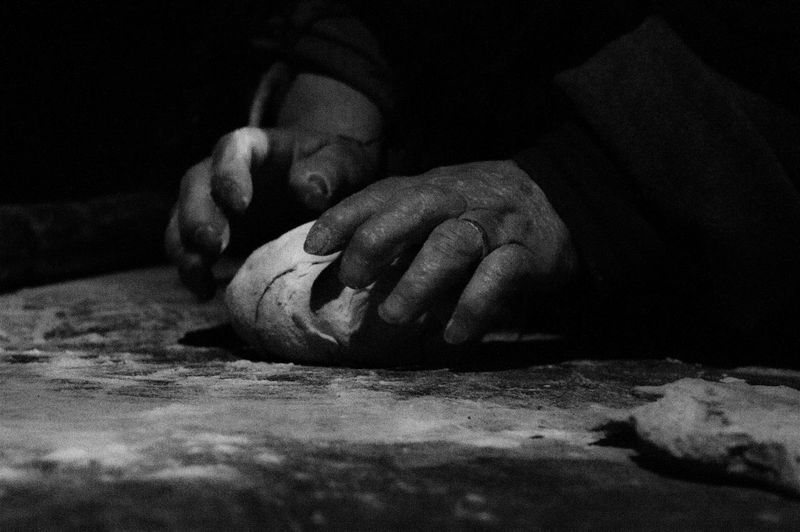 Close-up of woman working on table. presepe vivente a villa collemandina- living nativity