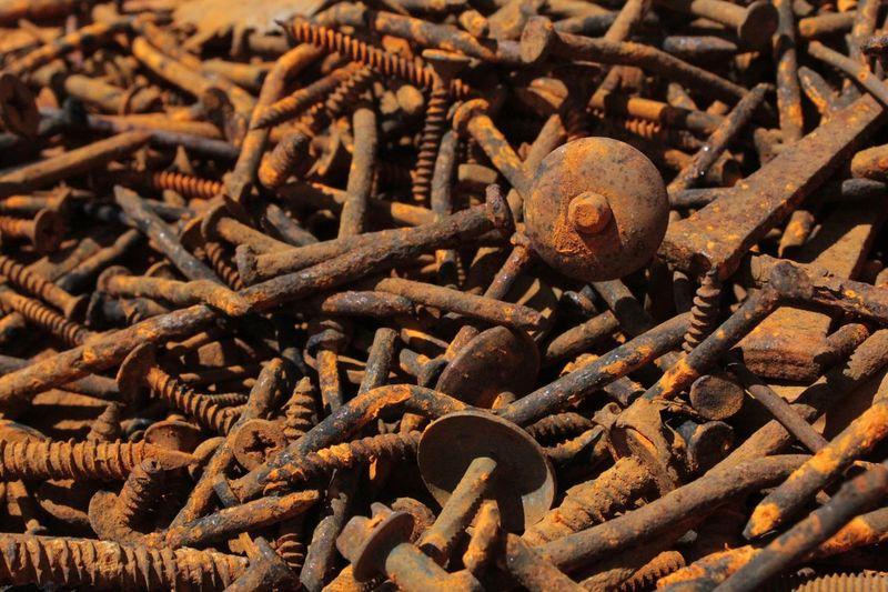 Full frame shot of rusty screws