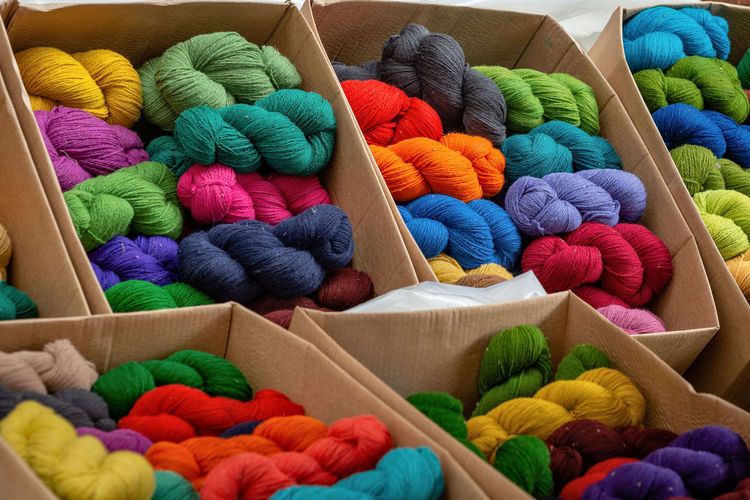 Different color yarns in boxes on the store shelf. Abundance Art And Craft Ball Of Wool Box Box - Container Choice Close-up Container Craft Creativity For Sale Indoors  Large Group Of Objects Material Multi Colored No People Softness Still Life Textile Variation Wool