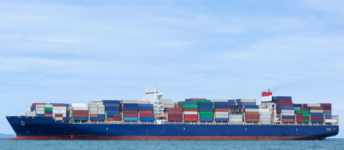 Cargo Container Nautical Vessel Freight Transportation Shipping  Water Ship Container Sea Transportation Container Ship Waterfront Commercial Dock Business Mode Of Transportation Sky Stack Industry Pier Nature Harbor No People Outdoors