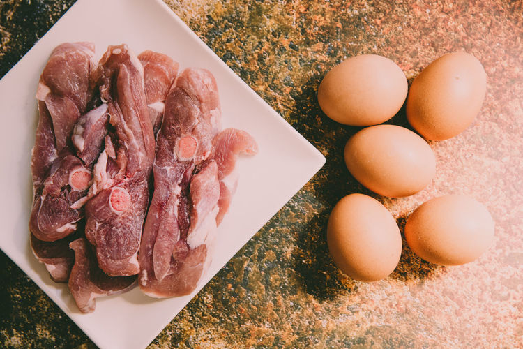 High angle view of eggs in plate on table