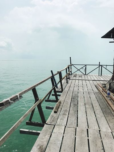 Kelong fish port, Malacca Sea Water Railing Sky Pier Wood - Material Tranquility Jetty Scenics Nature Day Tranquil Scene Outdoors Beauty In Nature Horizon Over Water Wood Paneling No People