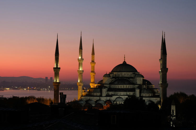 Sultan ahmed mosque at sultanahmet district against clear sky during sunset