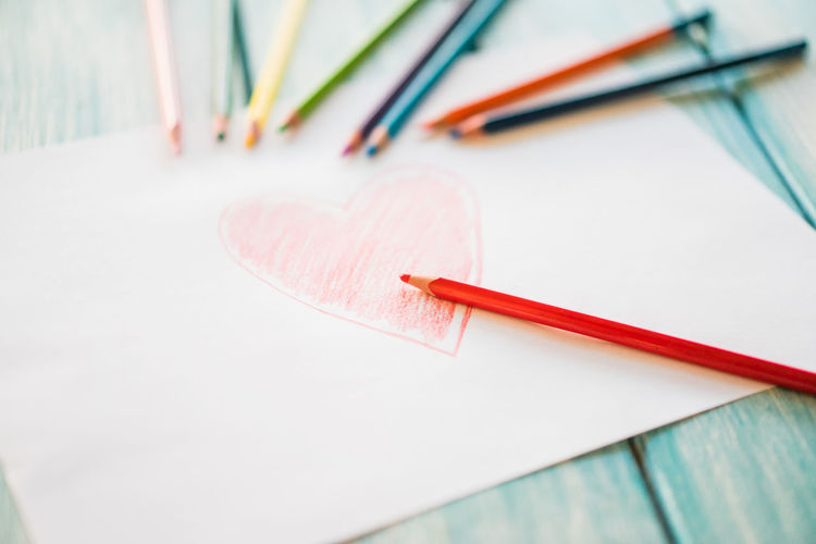 Art And Craft Art And Craft Equipment Close-up Colored Pencil Craft Creativity Focus On Foreground High Angle View Indoors  Multi Colored No People Paintbrush Paper Pencil Red Selective Focus Still Life Table Wood - Material Writing Instrument