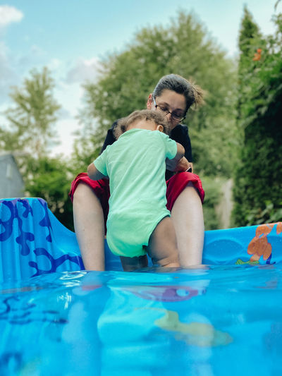 Rear view of two girls in swimming pool
