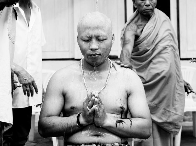 Buddhism Thailand Adult Day Human Hand Lifestyles Men Monk  Ordain People Real People Shirtless Sitting Togetherness