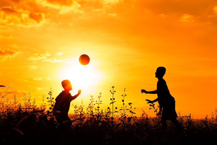 Children Football Fun Happy Kids Nature Running Silhouette Ball Botany Boy Boys Carefree Holding Little Motion Patient Play Playing Shadows Skills  Sky Small Sunset Yellow Tones