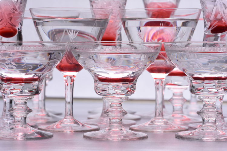 Close up of drinking glasses with alcohol Alcohol Arrangement Close-up Drink Food Food And Drink Freshness Glass Glass - Material Household Equipment Indoors  No People Red Red Wine Reflection Refreshment Still Life Table Transparent Wine Wineglass