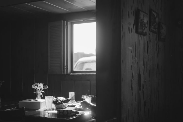 solitary diner Indoors  Window No People Day Nature Table Sunlight Home Interior Flowering Plant Flower Architecture Container Wall - Building Feature Domestic Room Absence Plant Glass - Material Wood - Material Transparent