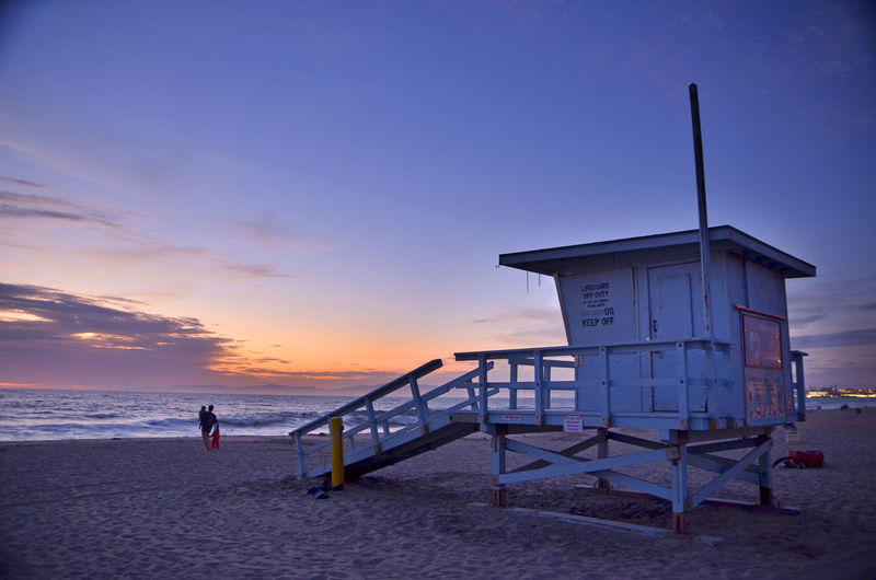 Lifeguard Hut At Beach Against Sky During Sunset
